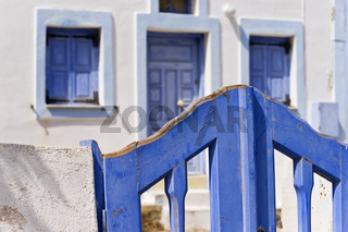 typical house colored white and blue on Santorini
