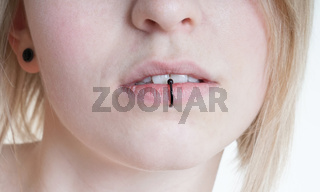 pierced female lips with vertical labret piercing or lip ring