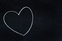 Heart shape written in white chalk