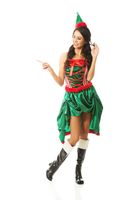 Portrait of woman wearing elf clothes pointing to the left