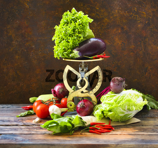 Autumn organic vegetables on wooden background with scale