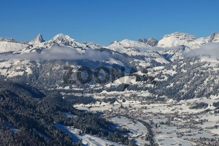 View from mount Hohe Wispile. Distant view of Saanen, village in the Swiss Alps. New snow.