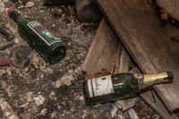 Two champagne and wine bottles are on the floor - Lost Place