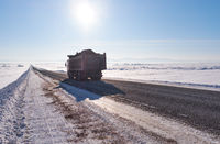 Kamaz truck on winter road and trees under snow in Altai