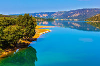 Lake Sainte-Croix-du-Verdon reflects wooded shore