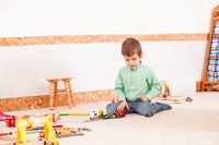Boy playing with toy  road