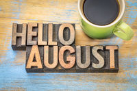 Hello August word abstract in wood type