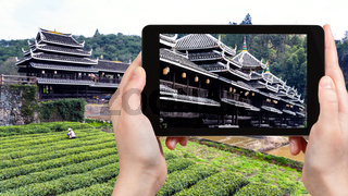 tourist photographs Chengyang Wind and Rain Bridge