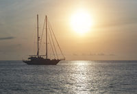 Yacht at Cala Saona in Formentera during sunset. Balearic Islands. Spain
