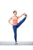 Woman doing Ashtanga Vinyasa yoga asana Utthita hasta padangusta