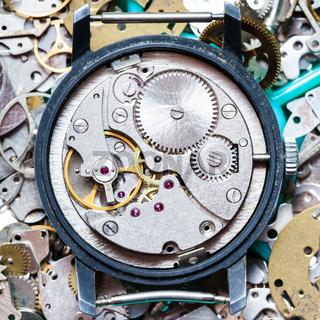 clockwork on heap of clock spare parts