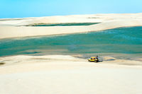 Buggy with tourists traveling through the desert Jericoacoara National Park, Ceara state, Brazil