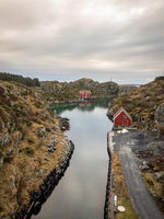 Rovaer in Haugesund, Norway - januray 11, 2018: The Rovaer archipelago in Haugesund, in the norwegian west coast. The small canal between the two islands Rovaer and Urd, vertical image