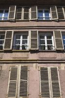 House facade with shutters in the old town of Colmar
