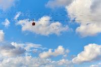 Cable car against blue cloudy sky. Barcelona. Spain