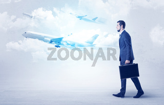 Businessman going somewhere with airplane