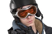 smiling young man with ski helmet and goggles, isolated on white