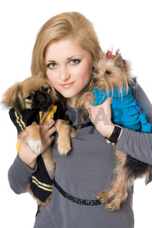 Portrait of pretty blonde with two dogs. Isolated on white