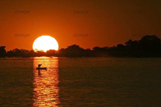 Sunset at River Chobe with fishing boat, Botsuana, Africa