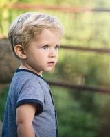 awesome infant boy looks towards