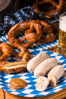 Bavarian sausage with pretzel, sweet mustard and beer