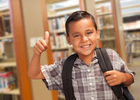 Hispanic Student Boy with Thumbs Up in the Library