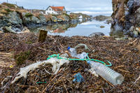 Plastic bottles and rubbish at the beach at Rovar, the island outside Haugesund, Norway.
