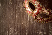 Carnival mask on the wooden background