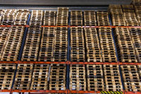 wooden cargo pallets storing at warehouse shelves