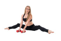 Pretty fitness trainer in black top with dumbbells