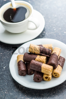 Sweet dessert. Biscuits rolls with chocolate.