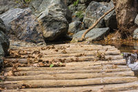 Old wooden bridge from logs in the gorge of Richtis at winter, Crete