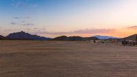 Desert nomad huts at sunset