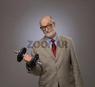 Senior man with dumbbell