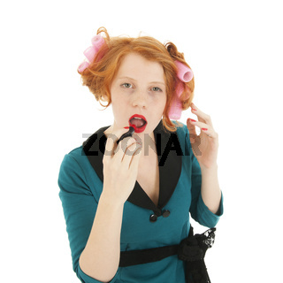 Woman with curlers and makeup