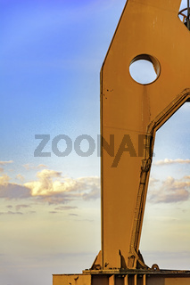 Detail of old crane with blue sky