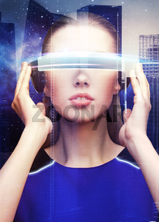 woman in virtual reality glasses over space city