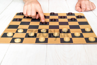 Child playing checkers board game