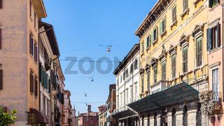 apartment houses on street in Verona city