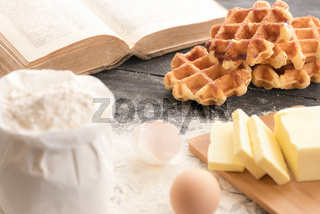 Waffles with ingredients and cookbook