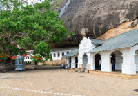 Dambulla golden temple cave complex buildinds is destination for pilgrims and tourists
