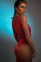 Fit and sporty woman in red swimsuit