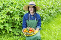Female gardener with vegetables