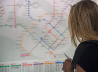 Traveler looking for way to the subway map