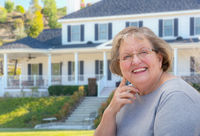 Senior Adult Woman in Front of House