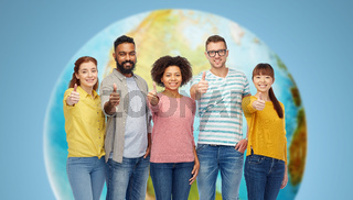international group of people showing thumbs up