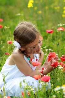 Girl with wild poppies