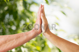 close up of senior and young woman hands touch