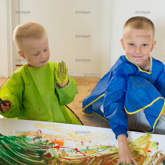 Children painting with their hands