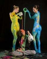 Naked girls their body covered with color bodyart